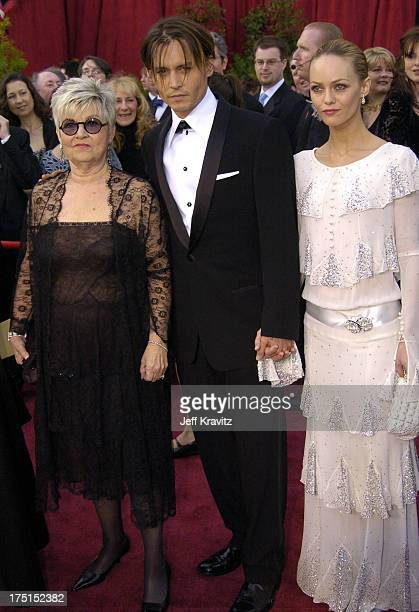 Johnny Depp with his mother and Vanessa Paradis during The 76th Annual Academy Awards - Arrivals by Jeff Kravitz at Kodak Theatre in Hollywood,...