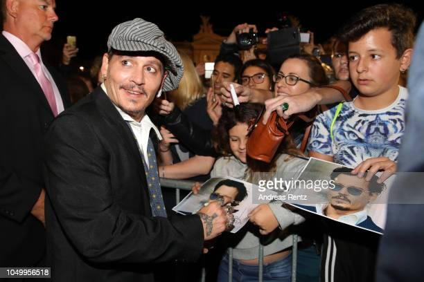 Johnny Depp writes autographs as he attends the 'Richard Says Goodbye' premiere during the 14th Zurich Film Festival at Festival Centre on October 05...