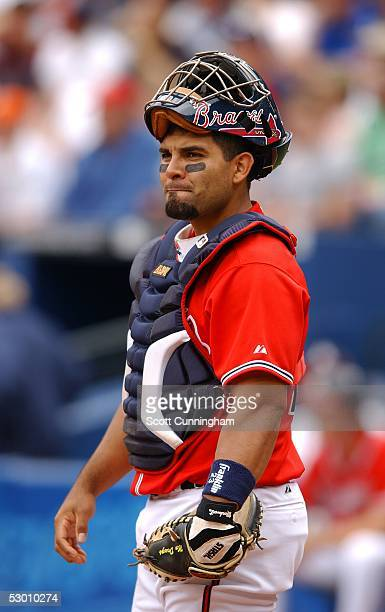 Johnny Estrada of the Atlanta Braves studies the action against the Philadelphia Phillies at Turner Field on May 29 2005 in Atlanta Georgia The...
