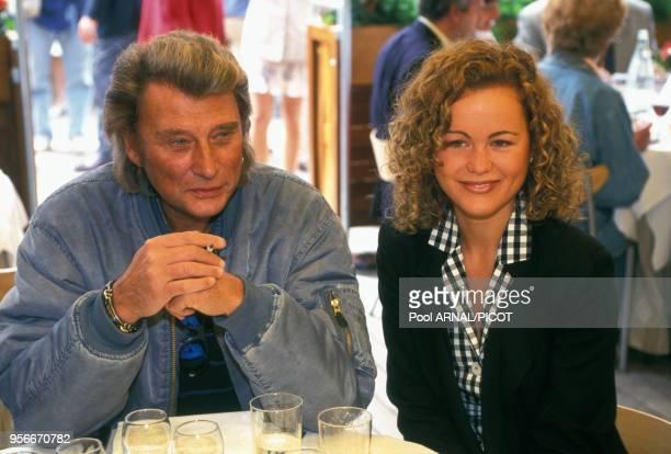 Johnny et Læticia Hallydayau tournoi de tennis de Roland Garros en juin 1995 Paris France