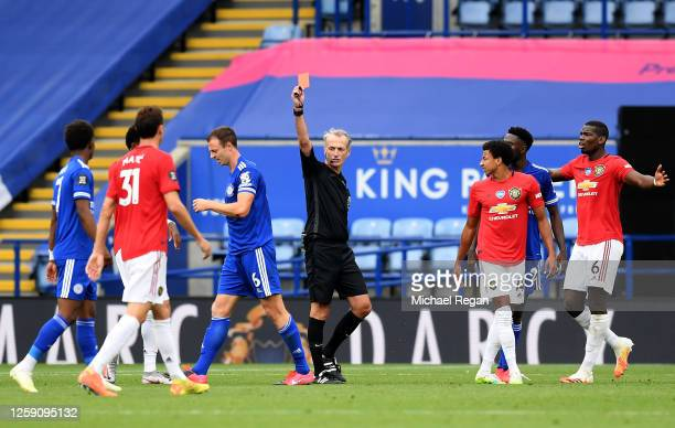 Johnny Evans of Leicester City is shown a red card by referee Martin Atkinson during the Premier League match between Leicester City and Manchester...