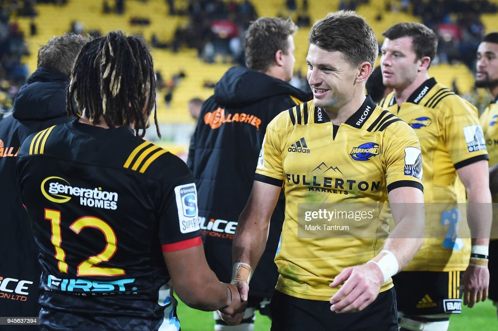 Johnny Faauli of the Chiefs and Beauden Barrett of the Hurricanes shake hands after the round nine Super Rugby match between the Hurricanes and the Chiefs at Westpac Stadium on April 13, 2018 in Wellington, New Zealand.