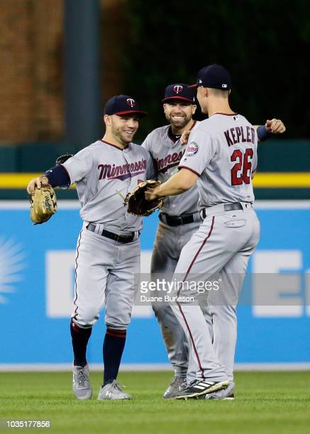 Johnny Field of the Minnesota Twins celebrates with Jake Cave and Max Kepler after a win over the Detroit Tigers at Comerica Park on September 17...