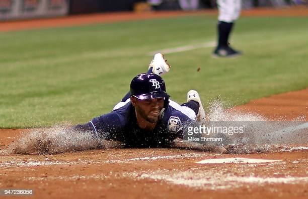 Johnny Field of the Tampa Bay Rays scores on a fielders choice in the second inning during a game against the Texas Rangers at Tropicana Field on...