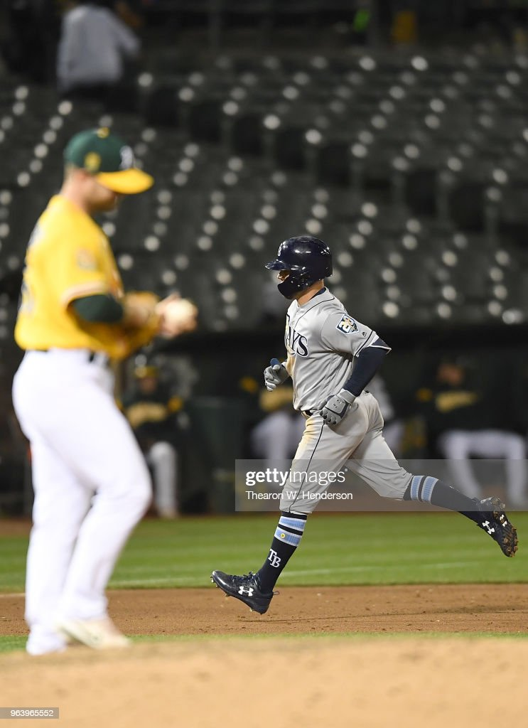 Johnny Field #10 of the Tampa Bay Rays trots around the bases after hitting a solo home run off of Daniel Coulombe #35 of the Oakland Athletics in the top of the eighth inning at the Oakland Alameda Coliseum on May 30, 2018 in Oakland, California. The Rays won the game 6-0.
