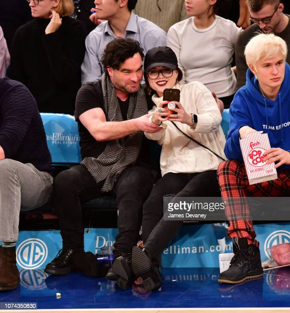 Johnny Galecki and Alaina Meye attend the Phoenix Suns v New York Knicks game at Madison Square Garden on December 17 2018 in New York City
