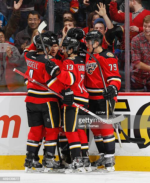 Johnny Gaudreau and David Jones of the Calgary Flames celebrate with teammates  after a goal against. New Jersey Devils ... 6cd2a14c9