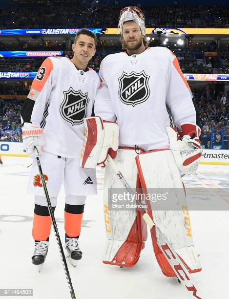 Johnny Gaudreau and Mike Smith of the Calgary Flames pose for a photo during warmup prior to the 2018 Honda NHL AllStar Game at Amalie Arena on...