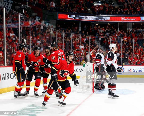 Johnny Gaudreau and Sean Monahan of the Calgary Flames and teammates celebrate a goal against the Arizona Coyotes during an NHL game on January 13...