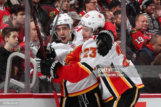 Johnny Gaudreau and Sean Monahan of the Calgary Flames react after Gaudreau scored in the first period against the Chicago Blackhawks at the United...