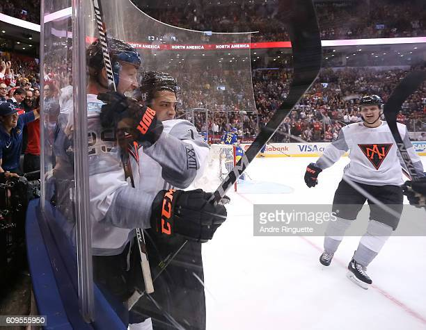 Johnny Gaudreau celebrates with Nathan MacKinnon of Team North America after scoring a first period goal on Team Sweden during the World Cup of...