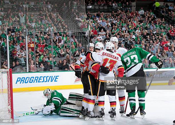 Johnny Gaudreau Jiri Hudler Sean Monahan and the Calgary Flames celebrate a goal against the Dallas Stars at the American Airlines Center on March 30...
