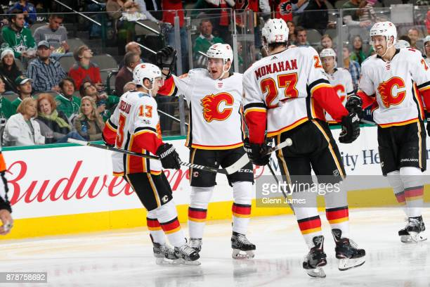 Johnny Gaudreau Michael Ferland Sean Monahan and Dougie Hamilton of the Calgary Flames celebrate a goal against the Dallas Stars at the American...