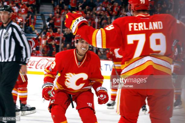 Johnny Gaudreau Micheal Ferland and teammates of the Calgary Flames celebrate a goal against the Montreal Canadiens during an NHL game on March 9...
