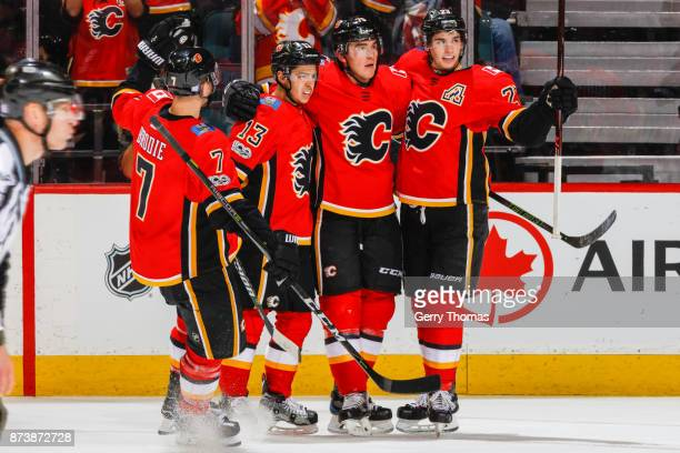 Johnny Gaudreau Micheal FerlandTJ Brodie and Sean Monahan of the Calgary Flames of the Calgary Flames celebrate in an NHL game against the St Louis...