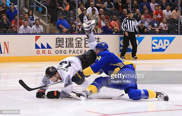 Johnny Gaudreau of Team North America collides with Mattias Ekholm of Team Sweden during the World Cup of Hockey 2016 at Air Canada Centre on...