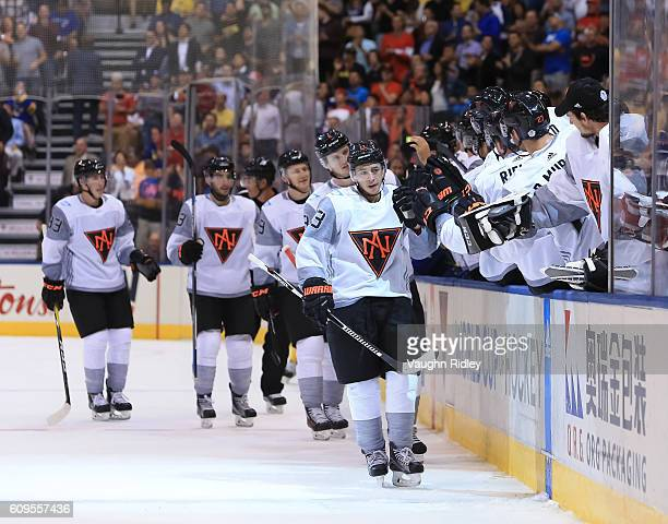 Johnny Gaudreau of Team North America high fives the bench after scoring a first period goal Team Sweden during the World Cup of Hockey 2016 at Air...