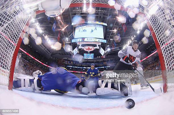 Johnny Gaudreau of Team North America scores at 1357 of the first period against Henrik Lundqvist of Team Sweden at the World Cup of Hockey...
