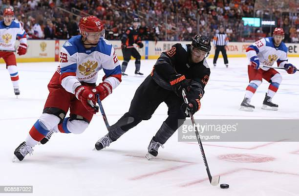 Johnny Gaudreau of Team North America stickhandles the puck with pressure from Nikita Zaitsev of Team Russia during the World Cup of Hockey 2016 at...