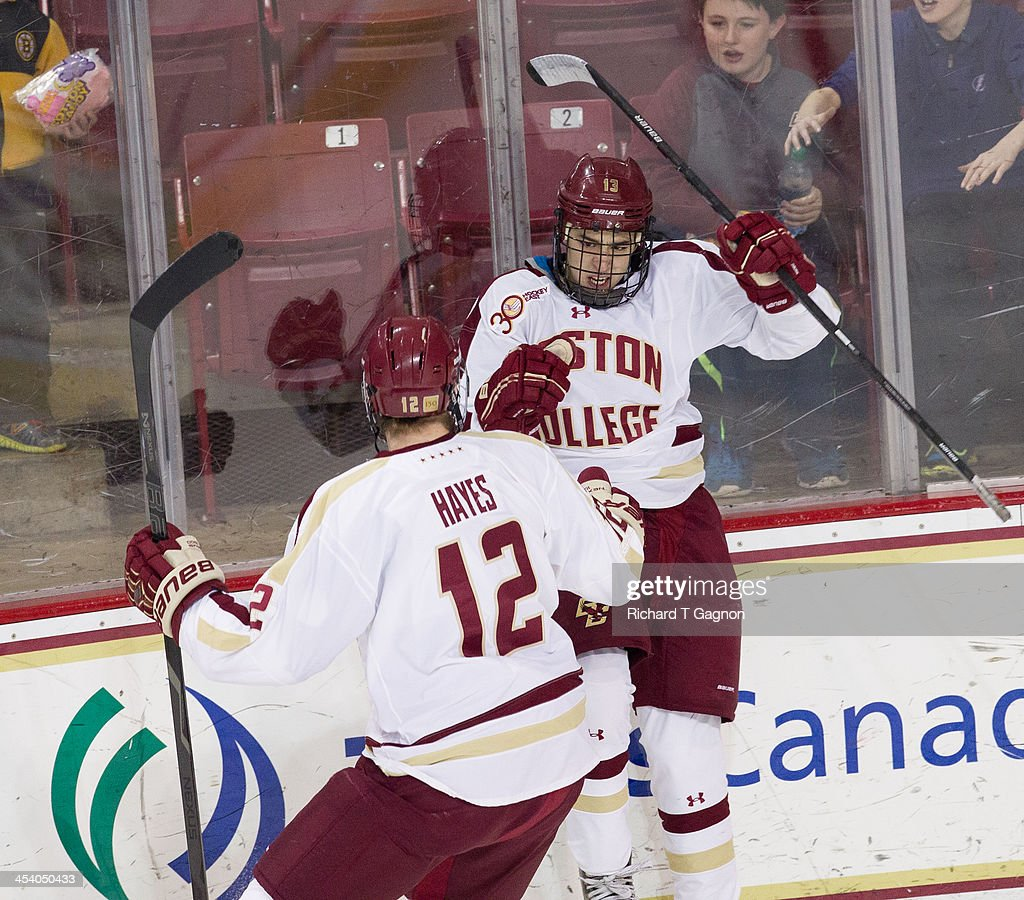Johnny Gaudreau #13 of the Boston College Eagles celebrates his first period goal with Kevin Hayes #12 during NCAA hockey action against the New Hampshire Wildcats at the Kelley Rink on December 6, 2013 in Chestnut Hill, Massachusetts.