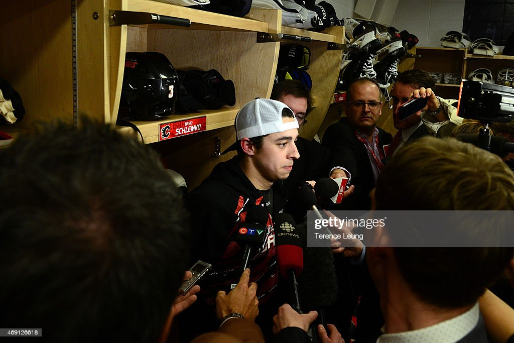 Johnny Gaudreau #13 of the Calgary Flames addresses the media after a 3-1 win against the Los Angeles Kings at Scotiabank Saddledome on April 9, 2015 in Calgary, Alberta, Canada.