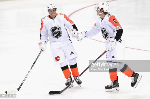 Johnny Gaudreau of the Calgary Flames and Brock Boeser of the Vancouver Canucks celebrate during the 2018 Honda NHL AllStar Game between the Atlantic...