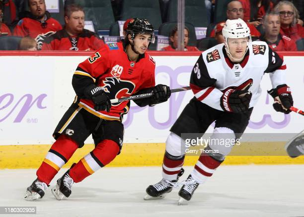 Johnny Gaudreau of the Calgary Flames and Christian Fischer of the Arizona Coyotes skate during an NHL game on November 5 2019 at the Scotiabank...