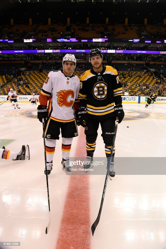 Johnny Gaudreau #13 of the Calgary Flames and David Pastrnak #88 of the Boston Bruins pose for a photo before the game at the TD Garden on February 13, 2018 in Boston, Massachusetts.