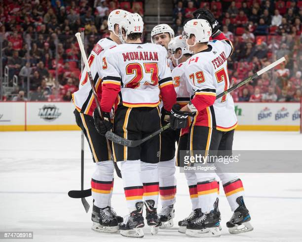 Johnny Gaudreau of the Calgary Flames celebrates his second period goal with teammates Sean Monahan and Micheal Ferland during an NHL game against...