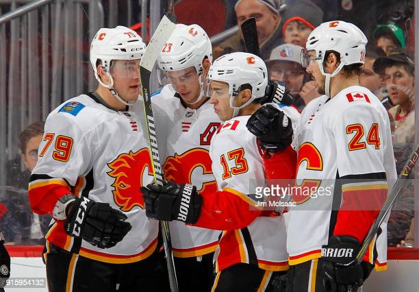 Johnny Gaudreau of the Calgary Flames celebrates his second period goal against the New Jersey Devils with teammates Micheal Ferland Sean Monahan and...