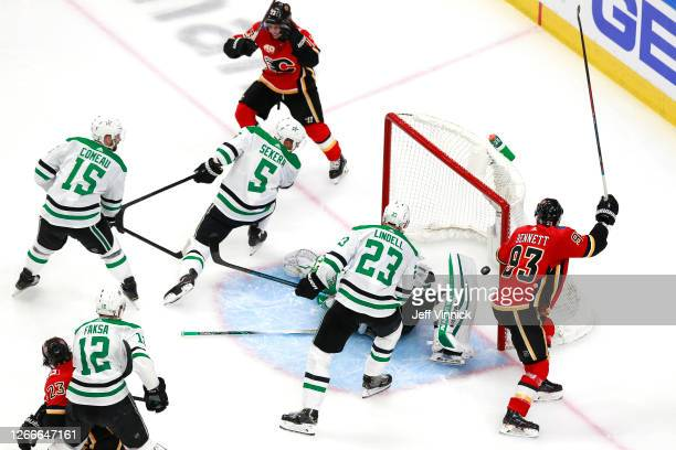 Johnny Gaudreau of the Calgary Flames celebrates with his teammates after scoring a goal on Anton Khudobin of the Dallas Stars during the second...