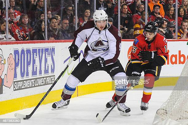 Johnny Gaudreau of the Calgary Flames chases Matt Duchene of the Colorado Avalanche during an NHL game at Scotiabank Saddledome on March 23 2015 in...