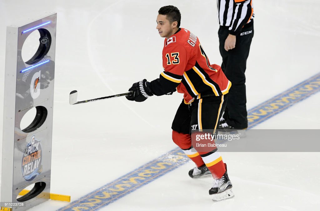 Johnny Gaudreau #13 of the Calgary Flames competes in the Gatorade NHL Puck Control Relay during 2018 GEICO NHL All-Star Skills Competition at Amalie Arena on January 27, 2018 in Tampa, Florida.