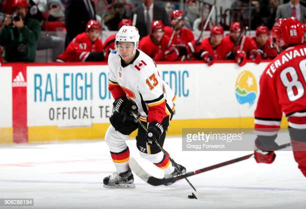 Johnny Gaudreau of the Calgary Flames drags the puck over the blueline during an NHL game against the Carolina Hurricanes on January 14 2018 at PNC...