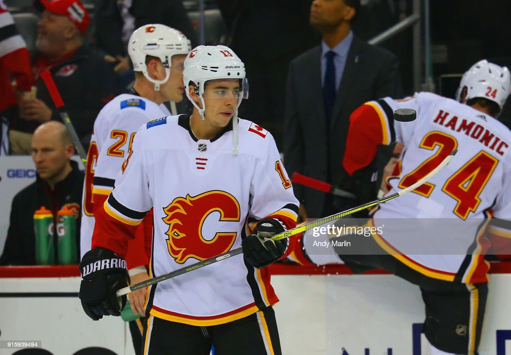 Johnny Gaudreau #13 of the Calgary Flames flips a puck during pregame warmups prior to the game against the New Jersey Devils at Prudential Center on February 8, 2018 in Newark, New Jersey.