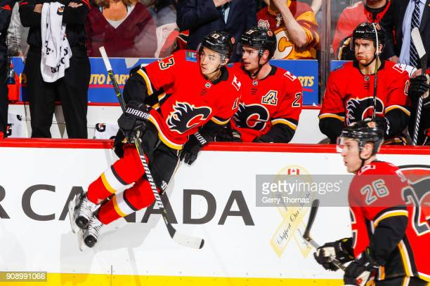 Johnny Gaudreau of the Calgary Flames jumps to the ice in an NHL game on January 22 2018 at the Scotiabank Saddledome in Calgary Alberta Canada