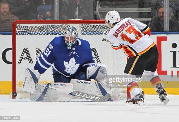 Johnny Gaudreau of the Calgary Flames just misses an attempt on Frederik Andersen of the Toronto Maple Leafs during an NHL game at the Air Canada...
