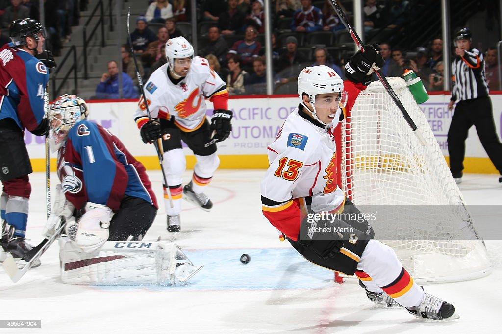 Johnny Gaudreau #13 of the Calgary Flames reacts after scoring a goal against goaltender Semyon Varlamov #1 of the Colorado Avalanche at the Pepsi Center on November 3, 2015 in Denver, Colorado.