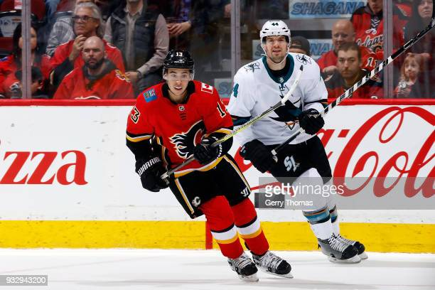 Johnny Gaudreau of the Calgary Flames skates against Marc EdouardVlasic of the San Jose Sharks during an NHL game on March 16 2018 at the Scotiabank...