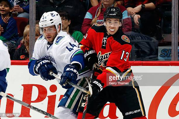 Johnny Gaudreau of the Calgary Flames skates against Matt Bartkowski of the Vancouver Canucks during an NHL game on April 7, 2016 at the Scotiabank...