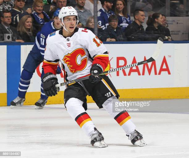 Johnny Gaudreau of the Calgary Flames skates against the Toronto Maple Leafs during an NHL game at the Air Canada Centre on December 6 2017 in...