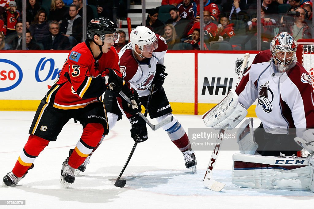Johnny Gaudreau #13 of the Calgary Flames skates against Tyson Barrie #4 and Semyon Varlamov #1 of the Colorado Avalanche at Scotiabank Saddledome on March 23, 2015 in Calgary, Alberta, Canada.