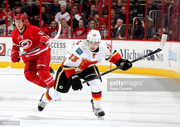 Johnny Gaudreau of the Calgary Flames skates for position on the ice during their NHL game against the Carolina Hurricanes at PNC Arena on November...