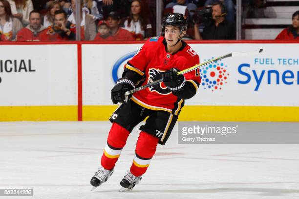 Johnny Gaudreau of the Calgary Flames skates in an NHL game against the Winnipeg Jets at the Scotiabank Saddledome on October 07 2017 in Calgary...