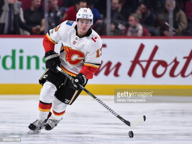 Johnny Gaudreau of the Calgary Flames skates the puck against the Montreal Canadiens during the NHL game at the Bell Centre on December 7 2017 in...