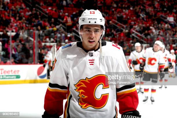 Johnny Gaudreau of the Calgary Flames skates toward the door at the end of the first period of play during an NHL game against the Carolina...