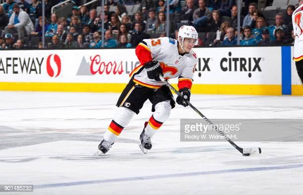 Johnny Gaudreau of the Calgary Flames skates with the puck against the San Jose Sharks at SAP Center on December 28 2017 in San Jose California
