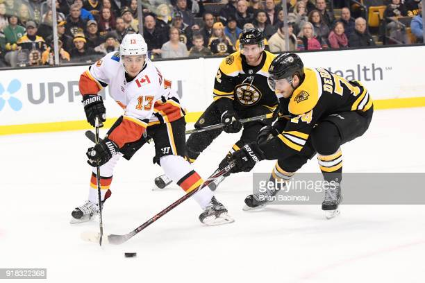 Johnny Gaudreau of the Calgary Flames skates with the puck against the Boston Bruins at the TD Garden on February 13 2018 in Boston Massachusetts