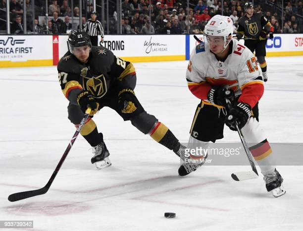 Johnny Gaudreau of the Calgary Flames skates with the puck against Shea Theodore of the Vegas Golden Knights in the first period of their game at...