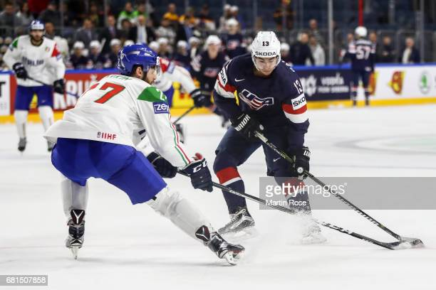 Johnny Gaudreau of USA challenges Thomas Larkin of Italy for the puck during the 2017 IIHF Ice Hockey World Championship game between USA and Italy...